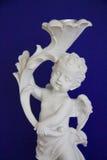 Cupidon sur le bleu Image stock