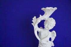 Cupidon sur le bleu Photographie stock libre de droits