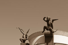 Cupids. Looking for new target (sculpture, Minsk, Belarus Royalty Free Stock Photography