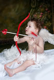 Cupids Arrow. Cupid shooting bow and heart shaped arrow royalty free stock photos