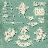 Cupids, arrows, hearts and other vintage elements Royalty Free Stock Photo