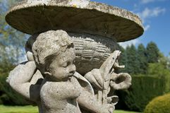 Cupids. Detail of Cupids on stone urn Stock Photography