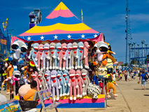 Cupie Dolls. A colorful stand burgeoning with stuffed animals, all prizes for a carnival game Royalty Free Stock Photo