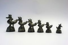 Bronze opium weights of roosters with cockscomb royalty free stock image