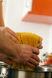 Cuple cooking pasta Stock Images