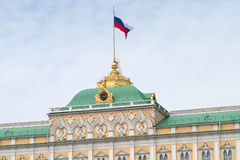 Cupola of Big Kremlin palace with flag. Green Cupola of Big Kremlin palace with Russian flag on spire royalty free stock image