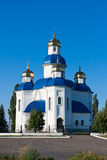 Cupola of church on blue sky bachground Stock Photos