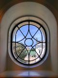 Cupola of monastery seen through the vintage window