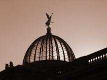 Cupola in Sepia. Glass and steel building with golden angel on top Royalty Free Stock Photo