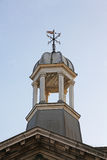 Weather-vane on cupola. A cupola topped with a weather-vane royalty free stock images
