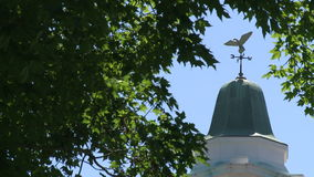 Cupola with weather vane on top of it. A view or scene from around town stock video