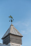 Cupola with Weather Vane Under Blue Sky Stock Images