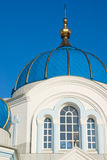 Cupola and windows. Tower of Orthodox church with blue cupola and three windows Stock Photo