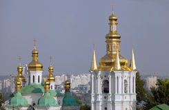 Cupolas of the church of the Nativity of the Virgin and Bell tower. Stock Photography