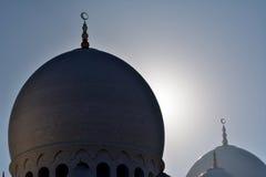 Cupole della moschea contro il sole Fotografie Stock
