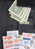 Cupones, dinero y caculator Foto de archivo libre de regalías