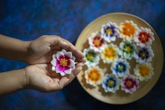 Hands holding a flower candle. Cupped hands with flower candle stock images