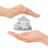 Cupped hands and house Stock Photo