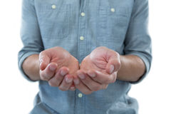 Cupped hands of man pretending to hold an invisible object Royalty Free Stock Photography