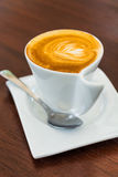 Cuppuccino in a white cup with saucer. Royalty Free Stock Images
