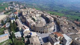 Cupramontana - Le Marche, Italy - aerial drone video. Over the ancient city with a view of the countryside in the distance stock footage