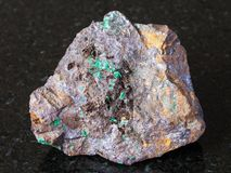 Cuprite and Malachite in Limonite mineral on dark royalty free stock photo