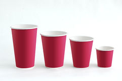 Cups. Red paper cups with different size stock photography