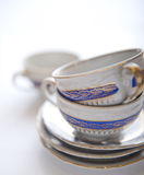 Cups. Two tea cups on some plates Stock Photo