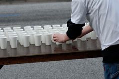 Cups. A volunteer at the marathon in Hamburg 2006, Germany Royalty Free Stock Photography