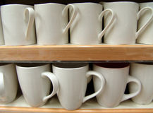 Cups. White mugs in thhe shelve Royalty Free Stock Image