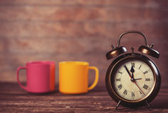 Cups and alarm clock Royalty Free Stock Image