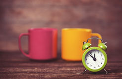 Cups and alarm clock Royalty Free Stock Images