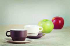 Cups and apples Stock Image