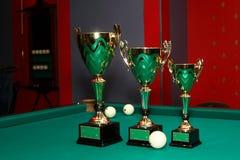 Beautiful cups, award winners in billiards. Cups for awarding in a billiard match royalty free stock photo