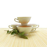Cups on the background of the mat. Composition of china cups on the background of the mat Royalty Free Stock Photo