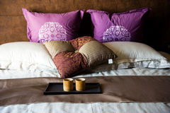 Cups on a bed. In a hotel room Royalty Free Stock Images