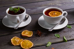 Cups of black tea. Black tea. Cups of tea with different spice and mint stock photo