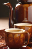 Cups of cappuccino and coffee pot Stock Image