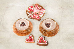 Cups of cappuccino and ginger biscuits in the form of hearts Royalty Free Stock Images