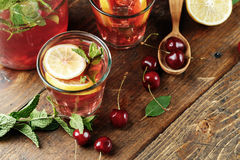 Cups with a cherry drink Royalty Free Stock Image