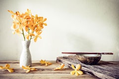 Cups and chopsticks with flower, home decoration concept Royalty Free Stock Photo