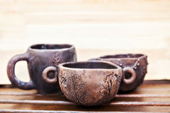 Cups of clay. Ceramic tableware handmade. Royalty Free Stock Photography