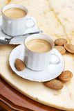 Cups of coffee. Capuccino and almonds,tasty beverage stock photography