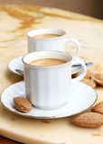 Cups of coffee. Capuccino and almonds,tasty beverage stock images