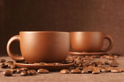 Cups of coffee and beans Stock Photos