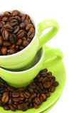 Cups and coffee beans (clipping path included). Green cups and coffee beans on white background (clipping path included Royalty Free Stock Photo