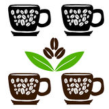 Cups of coffee with beans and leaves Stock Photo