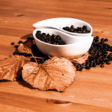 Cups with coffee beans on a wooden table Stock Photography