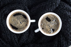 Cups of coffee and black woolen scarf Stock Images