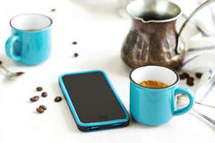 Cups of coffee and cellphone on table Royalty Free Stock Photos